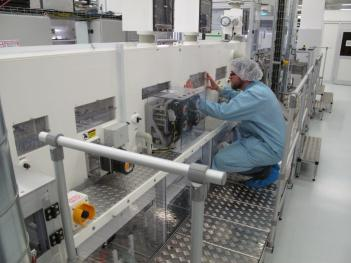 Philips employee in OLED lighting production line