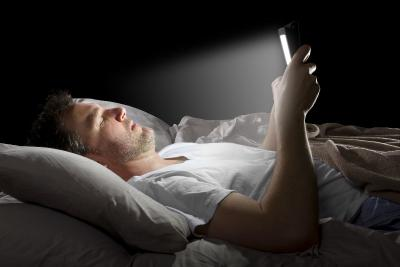 Reading a smartphone in bed photo